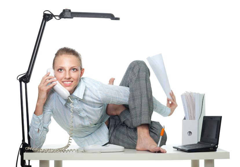 8036442 - flexible business woman talk by phone sitting in crooked pose and doing several things