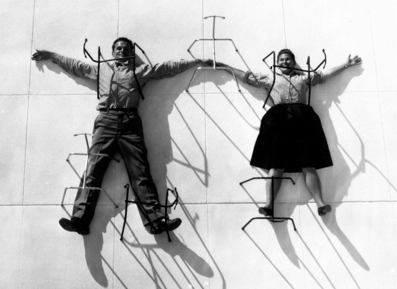 Charles and Ray Eames posing with metal chair bases, 1947 © Eames Office LLC