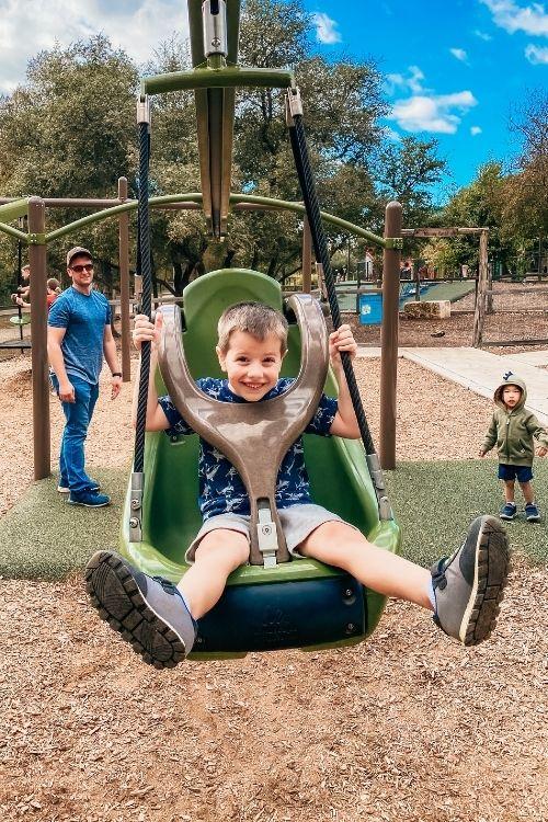 boy sitting in a swing