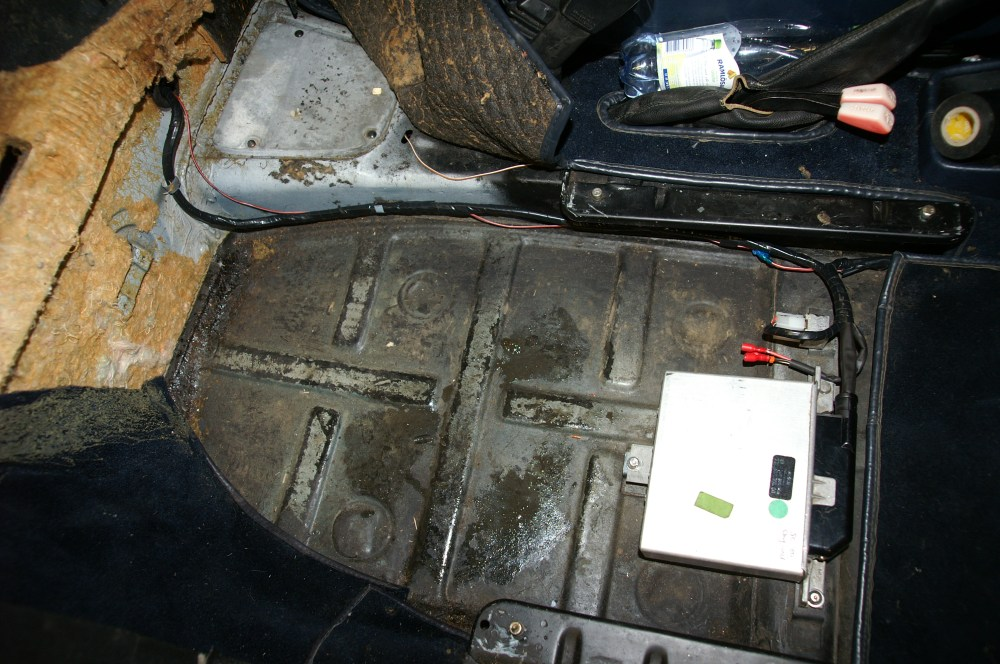 medium resolution of a cis control unit mounted under the passenger seat of a porsche 911 sc