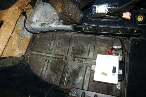 small resolution of a cis control unit mounted under the passenger seat of a porsche 911 sc