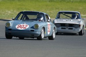 Steve Torps Porsche 912 leads Jeff Hill's Alfa Romeo Giulia Sprint into turn two.