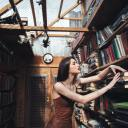 Young woman standing in library
