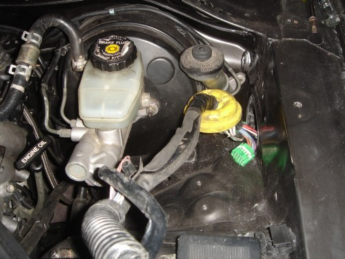 small resolution of the trick is to take a flat head screw driver put it into the thin slit and twist pull the wiring harness into the engine bay