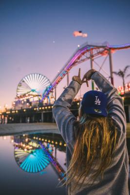 Girl making LA symbol with her hands at Santa Cruz