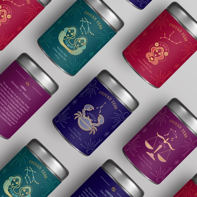 Collection of tea canisters in jewel-colored packaging with different zodiac signs
