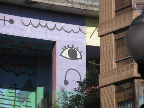 eye painted on concrete roadbridge