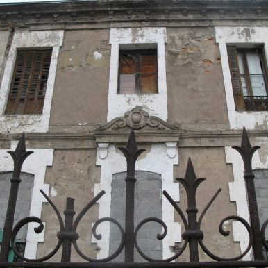 crumbly building with agressive railings