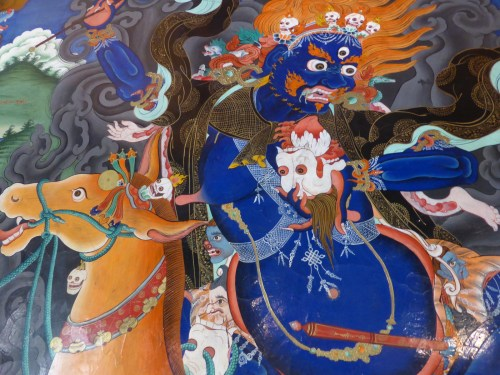 wall painting detail of blue deity on horseback