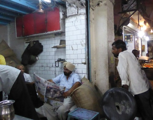 stallholders discussing newspaper article