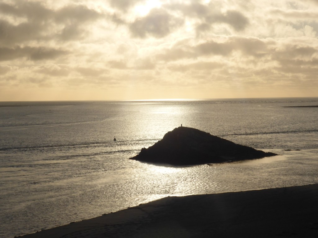 silver sea, black rock and beach