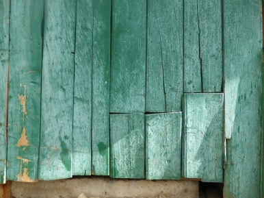 bleached green wooden wall-cladding