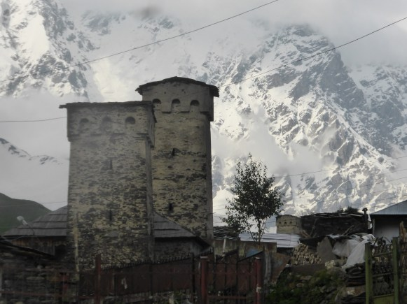 white-painted stone towers against snowy mountainside