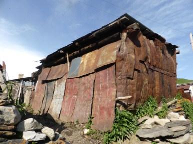battered metal sheets clad shed