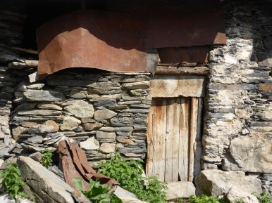 old stone, wood and metal house detail