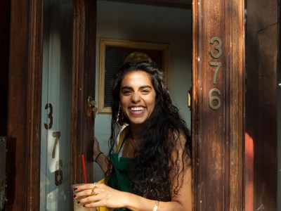 Mona Chalabi is all smiles in her 99U profile shoot.