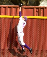 Tim Wilson from Linfield brings back a sure fire homerun. (Photo found on Linfield's press release)
