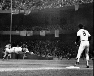 Pete Rose diving into third base