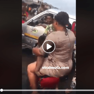 Ghanaian Hustler Carries Heavy Thick Lady Across A Flooded Road