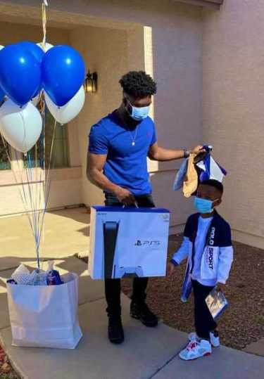 Nigerian Man Buys Son A PS5 On His 6th Birthday For Beating Cancer Twice During The COVID-19 Pandemic (Photos)