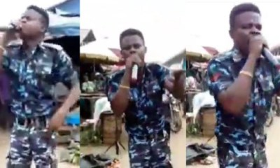 Police officer preaching at a market