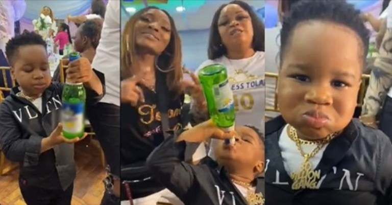 """""""This is just wickedness, failed parenting"""" – Nigerians react to video of a little boy drinking a bottle of beer [Video]"""