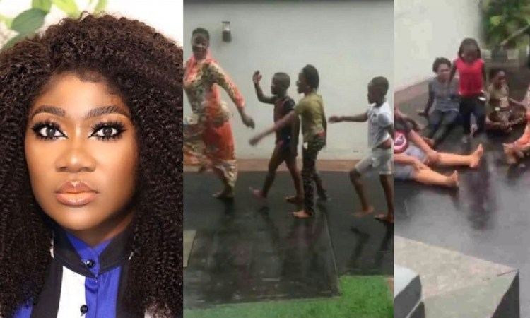 'She Is Too Real' – Fans React To Video Of Mercy Johnson Playing In The Rain With Her Children [Video]