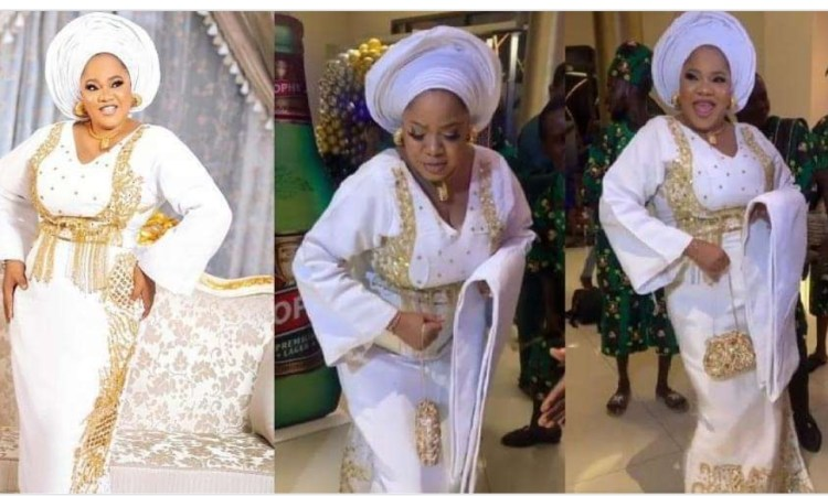 Fans react as Actress Toyin Abraham makes a grand entry at Ayinla movie premiere (video)