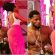 Caption this photo of D'banj staring hard at a lady's backside