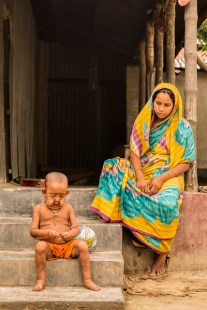 BANGLADESH – JULY, 15, 2016 : Four-year-old Bayezid Hossain with his mother Tripti Khatun, 18. Bayezid suffers a rare genetic disease which causes him to age faster than normal. He is pictured at his residence in Khalia village in Bangladesh. The rare syndrome in children is characterized by physical symptoms suggestive of premature old age. Photography by : Cover Asia Press / Qamruzzaman