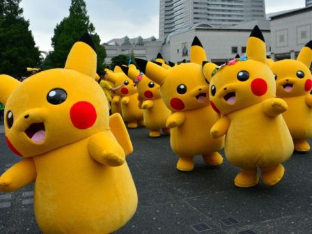 """Dozens of Pikachu characters, the famous character of Nintendo's videogame software Pokemon, parade at the Landmark Plaza shopping mall in Yokohama, suburban Tokyo on August 14, 2014. The Pikachu mascots walk around daily to attract summer vacationers as a part of the """"Great Pikachu Outbreak"""" event through the weekend. AFP PHOTO / Yoshikazu TSUNO (Photo credit should read YOSHIKAZU TSUNO/AFP/Getty Images)"""