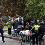 SYNAGOGUE SHOOTING LEAVES AT LEAST EIGHT DEAD