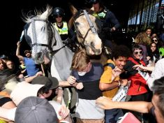 Climate protesters clash with police in Melbourne, scores injured