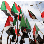 People wave national flags in a file photo during a protest in Khartoum, Sudan August 1, 2019. REUTERS/Mohamed Nureldin Abdallah/File Photo