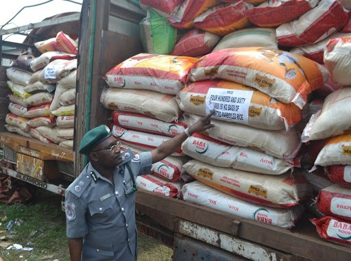 Buhari orders distribution of 150 truckloads of rice seized by customs to Nigerians