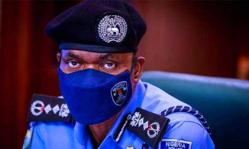 Inspector General of Police, IGP Mohammed Adamu wearing corona virus protection face masks