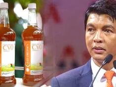 President Andry Rajoelina displaying Madagascar Corona virus Herbal Mixture