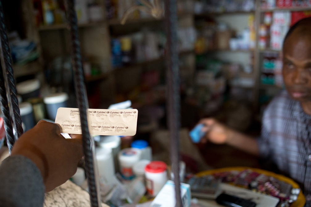 LAGOS, NIGERIA - AUGUST 31:  A  vendor sells a patient ten 200mcg pills of the prescription drug Cytotec-- enough to induce an abortion-- over the counter at a pharmacy in the Kirikiri neighborhood of Lagos, Nigeria, August 31, 2013.  Cytotec, a trade name for the drug misoprostal, is used at lower doses to induce labor and slow post-partum bleeding, but has been widely used for self-induced abortions in Nigeria. The ten pills cost 1,100 Naira, about $7US. (photo by Allison Shelley)