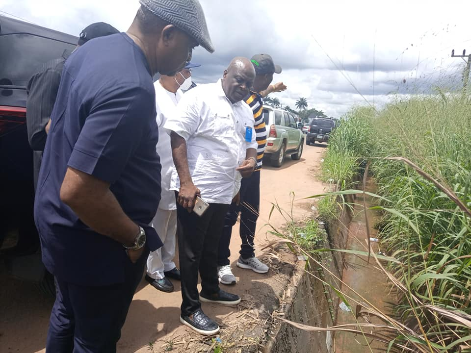 Imo state Minister of works Raph Nwosu inspecting a drainage system
