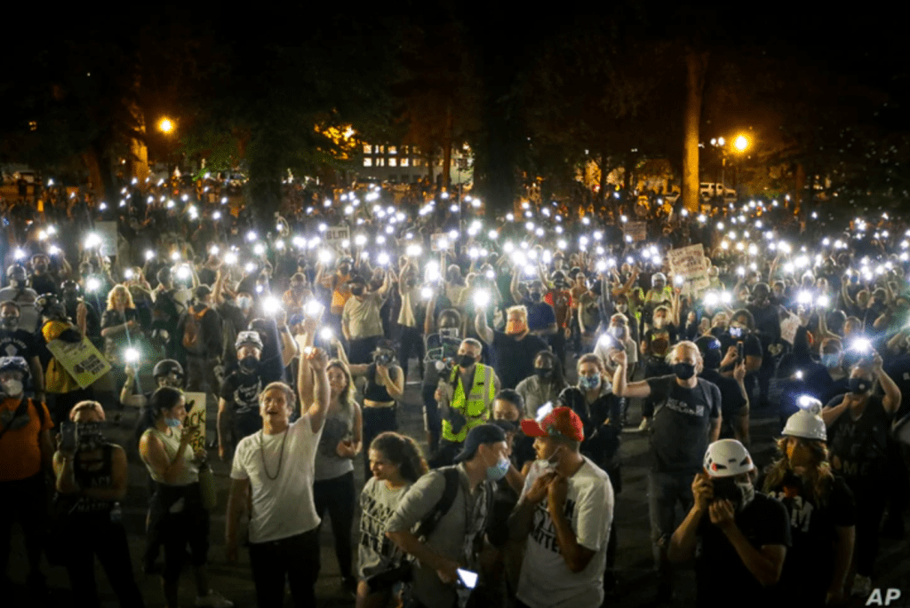 Demonstrators chant slogans during a Black Lives Matter protest at the Mark O. Hatfield United States Courthouse, July 29, 2020, in Portland, Oregon