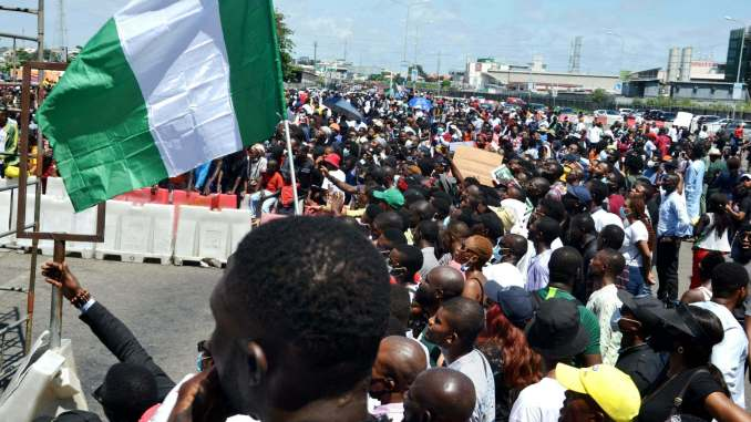 EndSars Protesters At Lekki Toll Gage Hold Nigerian Flags Before Being Shot At By Nigerian Military