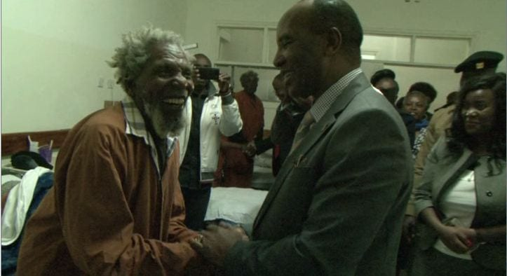 A Mau Mau war hero embraces Nyandarua Governor Francis Kimemia of Kenya on Tuesday, November 13, 2017