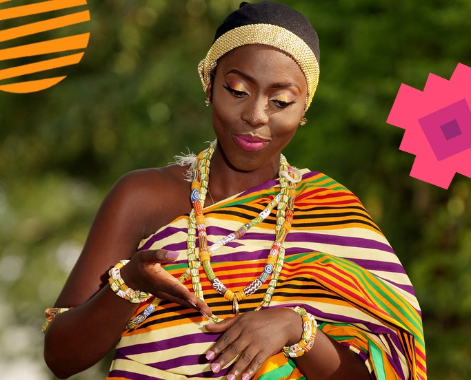 A Ghanaian girl dressed in traditional wears adorned with beads