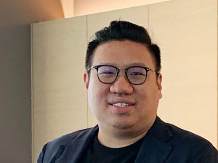 Trader Ng Yu Zhi