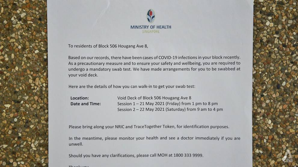 An MOH notice pasted at the void deck of Block 506 Hougang Avenue 8 on May 21, 2021. (Photo- Jeremy Long)