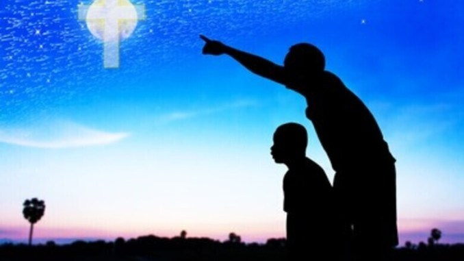 Father pointing out a cross to his son