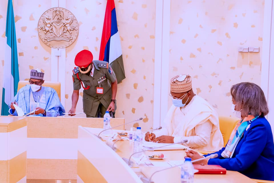 President Buhari receives briefing from Chairman and Members of Independent National Electoral Commission (INEC) in State House on 1st June 2021
