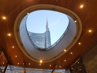 A shot of Milan's UniCredit building from within a gallery in Gae Aulenti Square.