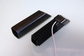 Start by pulling the USB plug through the top