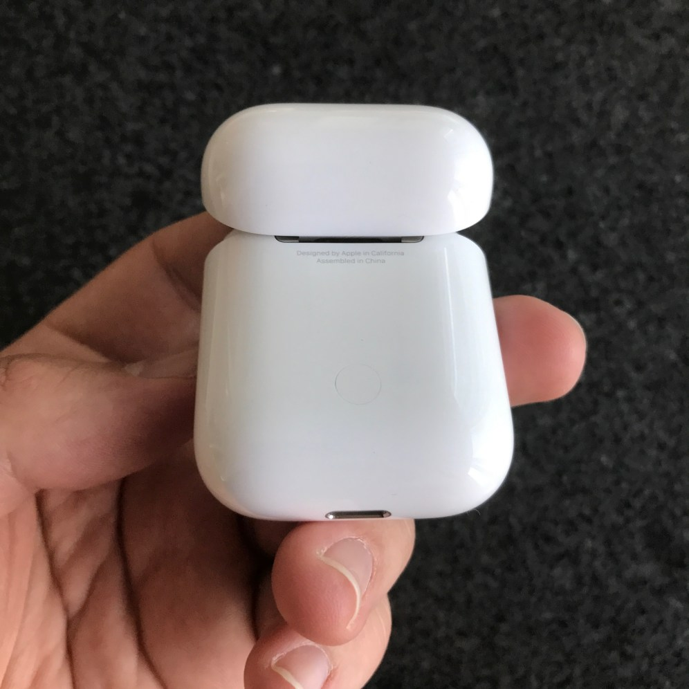 Apple AirPods charging case, pairing button
